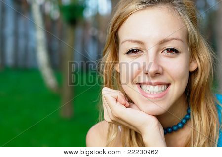 Young smiling girl at the park