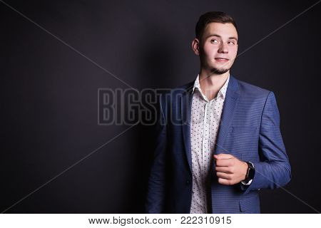 Successful business person with a business suit and white shirt. Stylish person. Man portrait. Young handsome person. Purposeful person. Man style. Business person  look at camera
