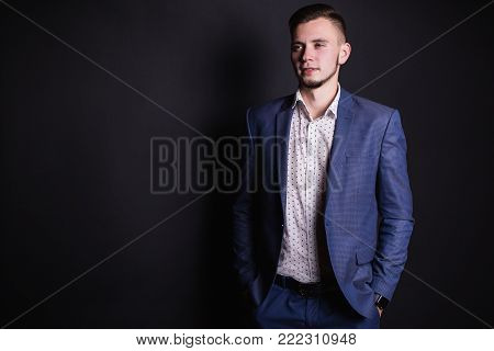 Successful business person with a business suit and white shirt. Stylish person. Man portrait. Young handsome person. Purposeful person. Man style. Business person  look at side of camera