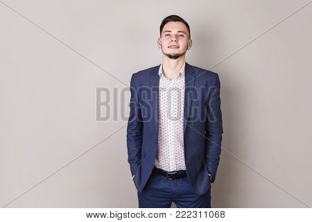 Successful young businessman with a business suit put hands in pocket. Stylish man put hands in pocket. Director of the firm. Hands in pocket. The young man put his hands in his pocket