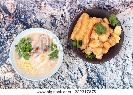 Chinese recipe,Rice porridge with  boiled egg ,Minced pork ,chicken liver, Ginger, onion and coriander served with Patongko ,deep-fried dough stick.