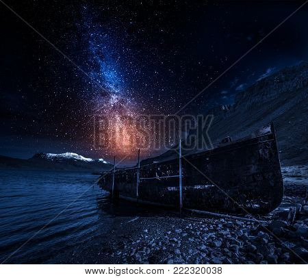 Old ship wreck at night with stars, Iceland
