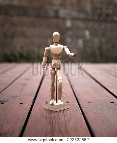 Wooden Articulating Mannequin for Drawing on Wooden Deck