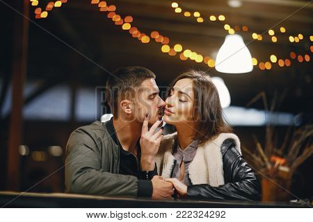 couple kissing in the restaurant while waiting for their food