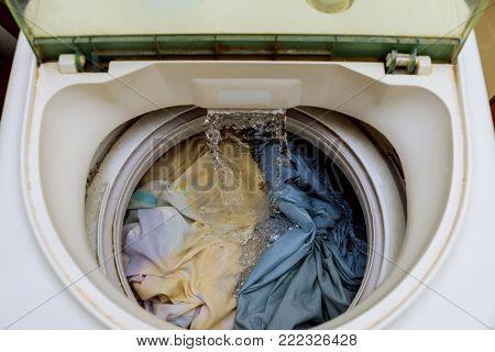 Internal view of a washing machine drum during wash into the washing machine