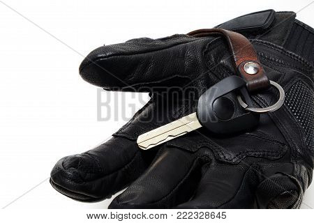 Black Genuine leather Motorcycle Glove with High Security Motorcycle Chip Key on iSolated White Background.