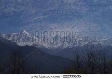 Clouds hovering over the Panchachuli Massif of the Himalayan Range, as seen from Munsiyari, Uttarakhand, India