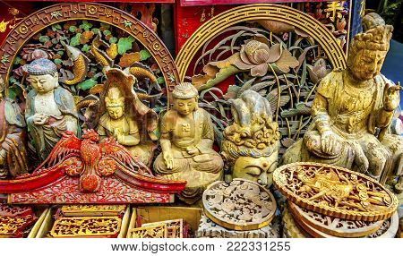 Chinese Replica Wooden Buddhas Decorations Panjuan Flea Market  Decorations Beijing China.  Panjuan Flea Curio market has many fakes, replicas and copies of older Chinese products, many ancient.