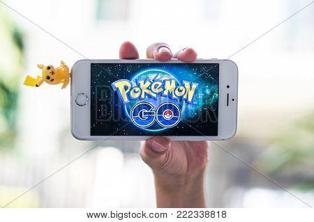 Bangkok, Thailand-february 15, 2018: Pokemon Go Mobile Game App On Smart Phone Gadget On Child Kid H