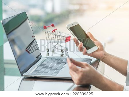 Online shopping and e-commerce digital marketing concept via credit card and internet banking on mobile smartphone app and wireless communication technology in people or shopper modern city lifestyle