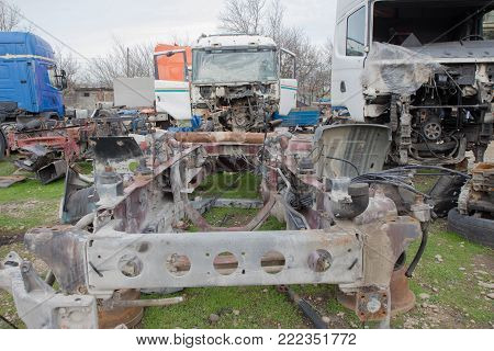Old ruined, abandoned trucks. The old truck graveyard. truck abandoned in junkyard field