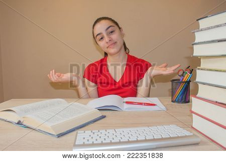 Thoughts, education, creativity concept. Portrait of pretty girl high school student studying and working on his homework
