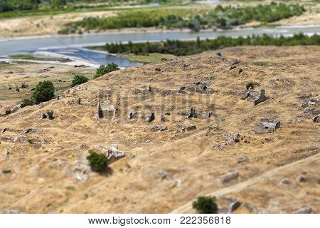The remains of the walls of the buildings of ancient people in Uplistsikhe, Georgia. Tilt-shift effect.