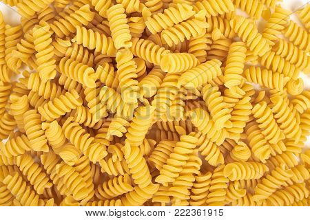 background of fusilli pasta noodles on white poster