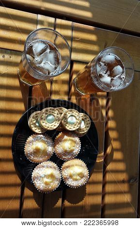 glasses full of fresh drink on ice