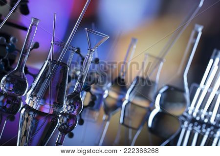 Science experiment concept with bokeh background, laboratory beakers.