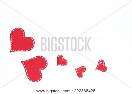 Red paper hearts isolated on white background. Valentine's Day. Copy space. Top view