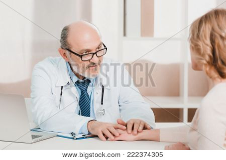 partial view of woman at doctors reception in clinic