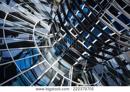 BERLIN, GERMANY - 11 AUG 2012: The transparent glass cupola and mirrors above the Parliament  chamber in Berlin, Germany.