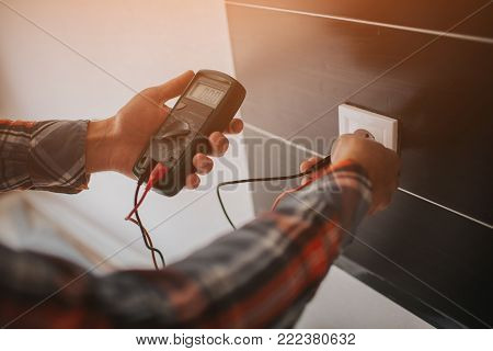 Electrician, Electrician installing new current socket with screwdriver. Installing electrical outlet or socket - closeup on electrician hands.