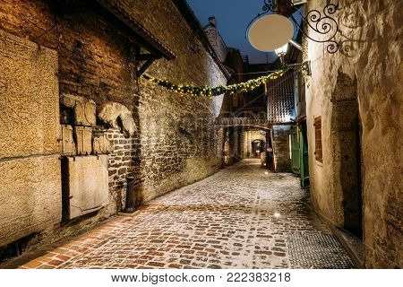 Tallinn, Estonia. Ancient Tombstones In St. Catherine's Passage From St. Catherine's Dominican Monastery At Night. Historic Centre Old Town Of Tallinn. UNESCO World Heritage Site