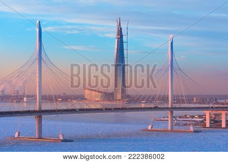 The cable-stayed bridge is the western high-speed diameter, and the tallest skyscraper in Europe - Lakhta center at sunset in winter in St. Petersburg. Russia. Saint-Petersburg. 16 January 2018