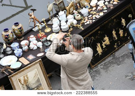Paris, France - July 14, 2014: An Outdoor Flea Market In Paris Set Up On Tables At The Edge Of The S
