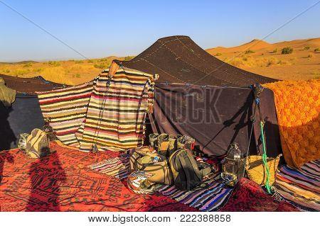Merzouga, Morocco - February 25, 2016: The Shadow Of A Photographer Falls Over The Colorful Rugs And