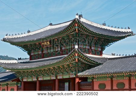 SEOUL, KOREA - AUGUST 31, 2008: View to the roof of the entrance gate of the Gyeongbokgung Royal Palace in Seoul, Korea.