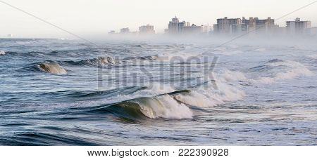 Waves and fog on Daytona Beach, Florida.