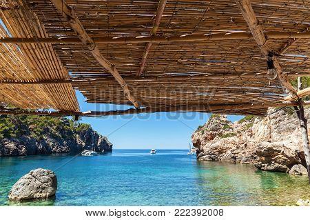 Palma de Mallorca, reed canopy on the beach overlooking the bay. the sea on Palma de Mallorca