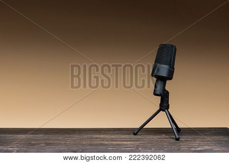 equipment for field audio recording on beige background. Usb microphone