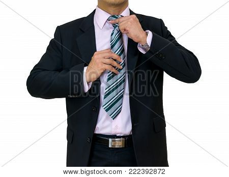 businessman put on a black suit necktie White background of isolated clipping path and selection path