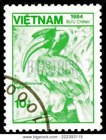 Ukraine - circa 2018: A postage stamp printed in Vietnam show bird Malay kalao, a rhinoceros bird - Great Hornbill or Buceros bicornis. Series: Fauna and Flora. Circa 1984.