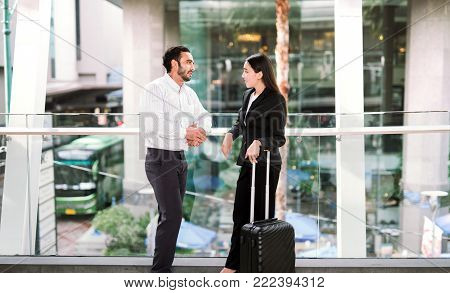 businessman and businesswoman talking at airport friend talking