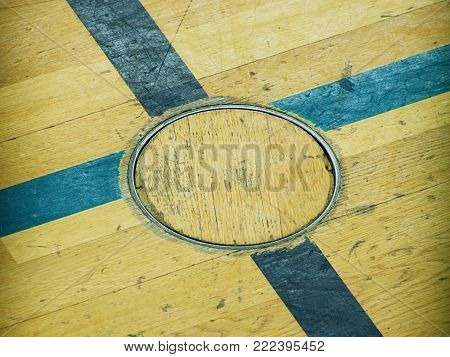 Crossed lines and steel locked cover for training equipment. Renewal wooden floor of sports hall with lacquered surface. School gym