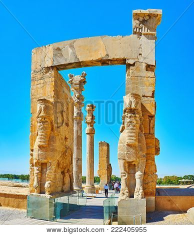PERSEPOLIS, IRAN - OCTOBER 13, 2017: All Nations Gate (Xerxes Gate) with its preserved statues, decors and columns is one of the most popular landmarks of Persepolis archaeological site, on October 13 in Persepolis.