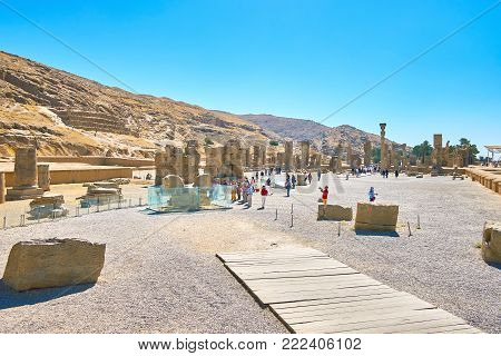 PERSEPOLIS, IRAN - OCTOBER 13, 2017: The walk to the Hundred Column Hall along the Unfinished Gate of Persepolis archaeological site, on October 13 in Persepolis.