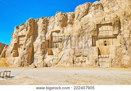 The ancient tombs of Achaemenid dynasty Kings of Persia are carved in rocky cliff in Naqsh-e Rustam, Iran.
