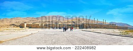PERSEPOLIS, IRAN - OCTOBER 13, 2017: Panorama of the archaeological site with preserved massive fortification wall, ancient ruins of palaces, temples and other buildings, on October 13 in Persepolis.