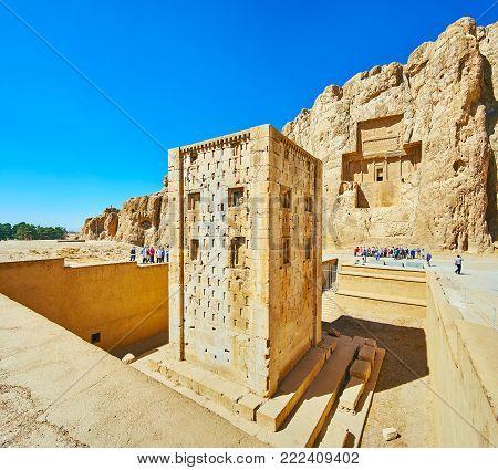 NAQSH-E RUSTAM, IRAN - OCTOBER 13, 2017: Discover Ka'ba-ye Zartosht tower and ancient mausoleums in rock in Naqsh-e Rustam Necropolis, on October 13 in Naqsh-e Rustam.