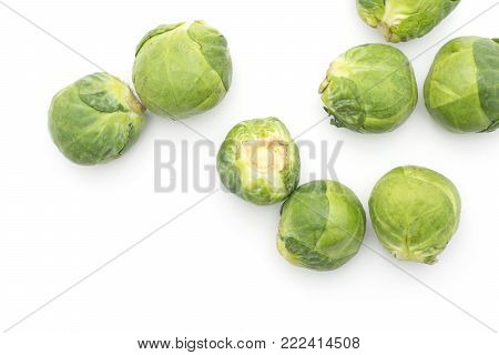 Raw Brussels sprout heads top view isolated on white background