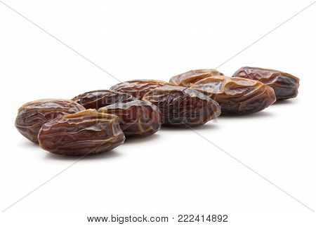 Date fruit Medjool isolated on white background ripe in row