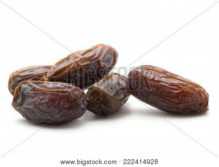 Five date fruits Medjool variety isolated on white background