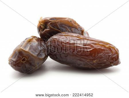 Three date fruits Medjool isolated on white background