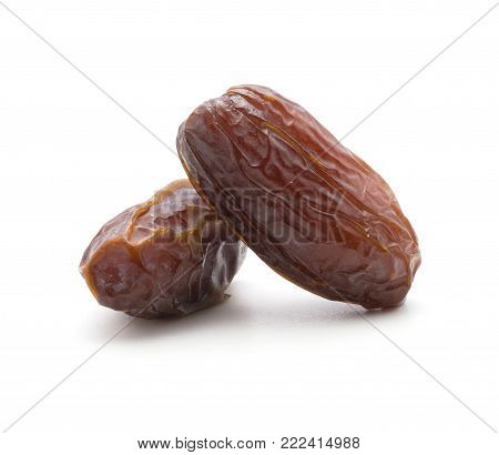 Two date fruits Medjool isolated on white background ripe and dried