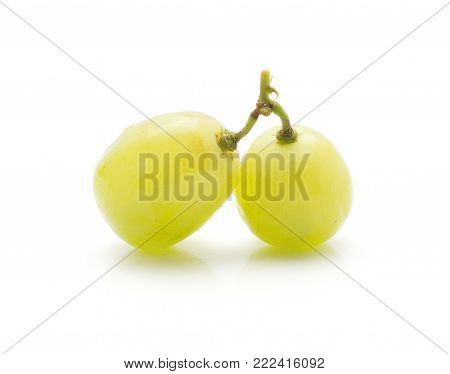 Two grape berries (Early Sweet or Grapaes variety) isolated on white background green ripe