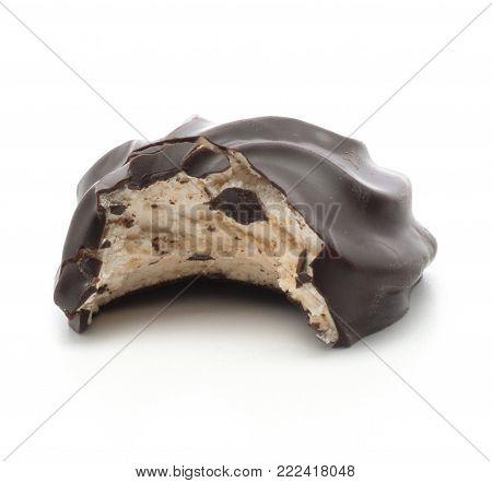 Bitten dark chocolate-coated zefir isolated on white background