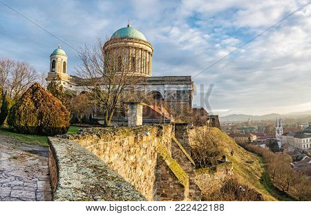 Esztergom Basilica with reflection in Danube river, Hungary. Night scene. Cultural heritage. Place of worship. Religious architecture.