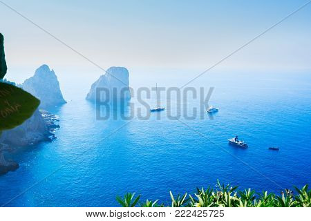 Famous Faraglioni cliffs and Tyrrhenian Sea blue water, Capri island, Italy